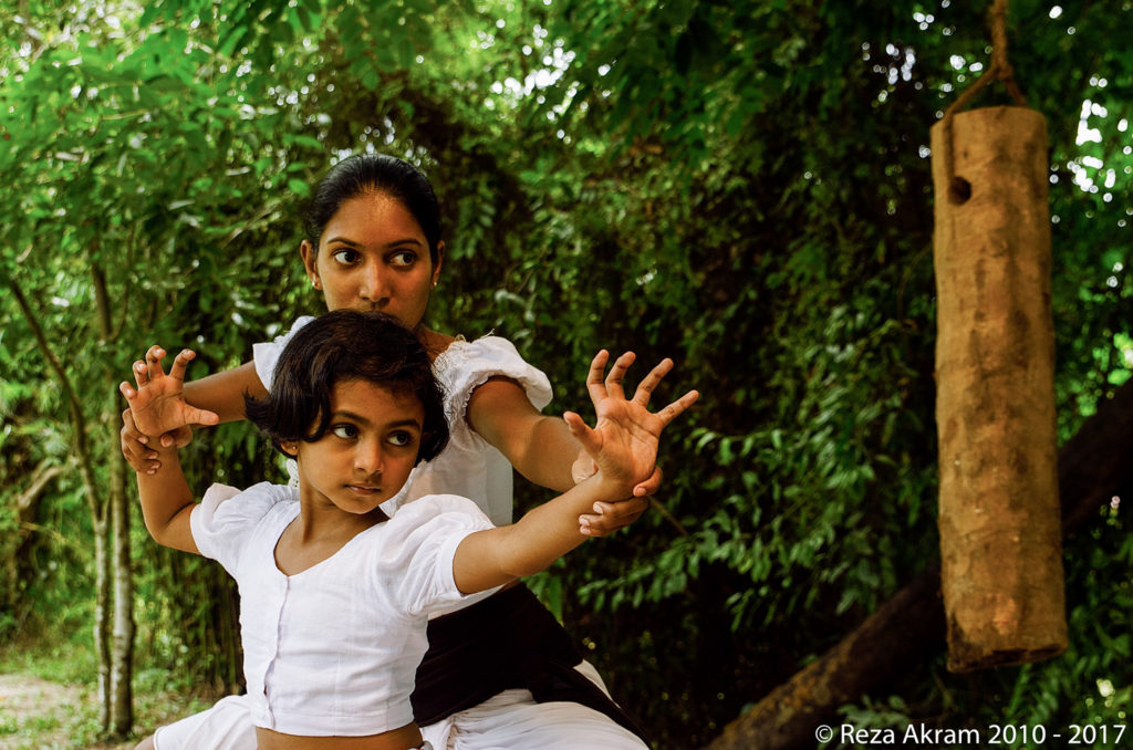 Since the distant past, women too practiced Angam in the same capacity as men. Female warriors such as Ratnapäli, Mahäpäli, Kaviläshapäli, and Navarathna Meniké, have been chronicled in many records throughout different eras of Sri Lanka's documented history. © Reza Akram 2010 - 2017